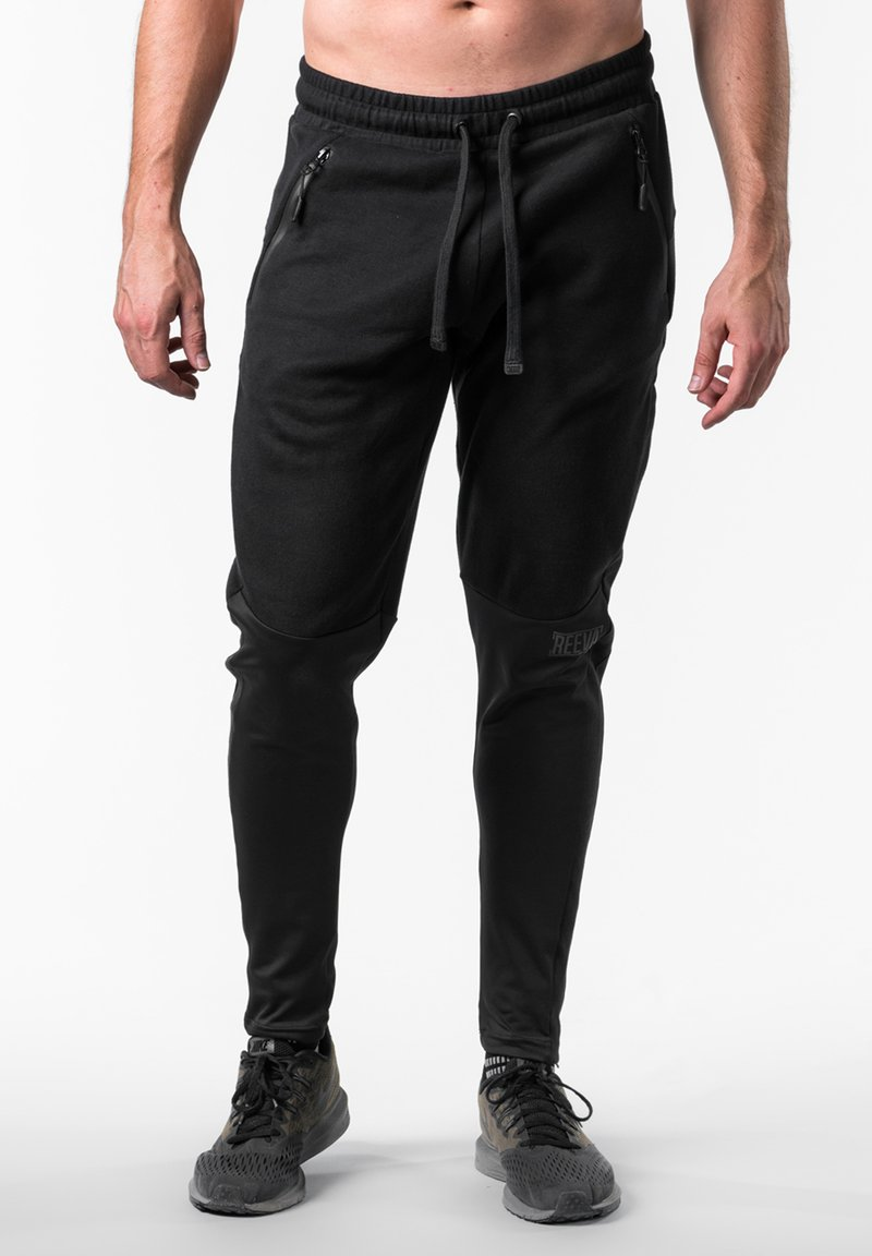 Reeva - Tracksuit bottoms - black