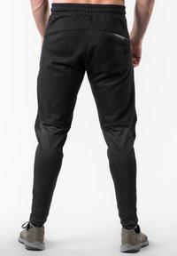 Reeva - Tracksuit bottoms - black - 2