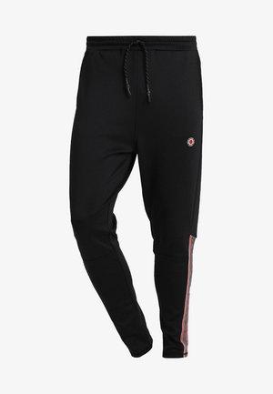 CRASH JOGGER - Pantalones deportivos - black/red