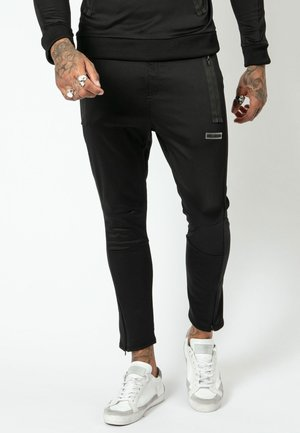 SHADOW  - Tracksuit bottoms - black