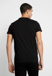 Religion - CORRECTION - T-shirts med print - black - 2