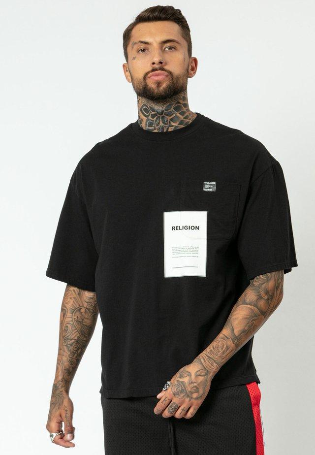 OVER LAY - Print T-shirt - black