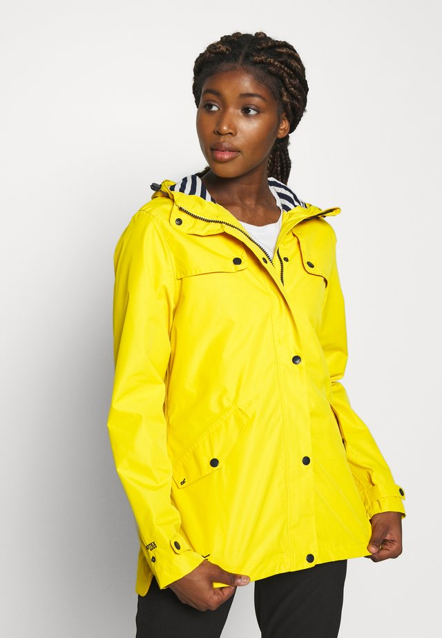 BERTILLE - Waterproof jacket - yellow sulphur