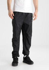 Regatta - ACTIVE - Pantalones - black - 0