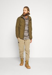 Regatta - HALDOR - Outdoor jacket - camo green - 1