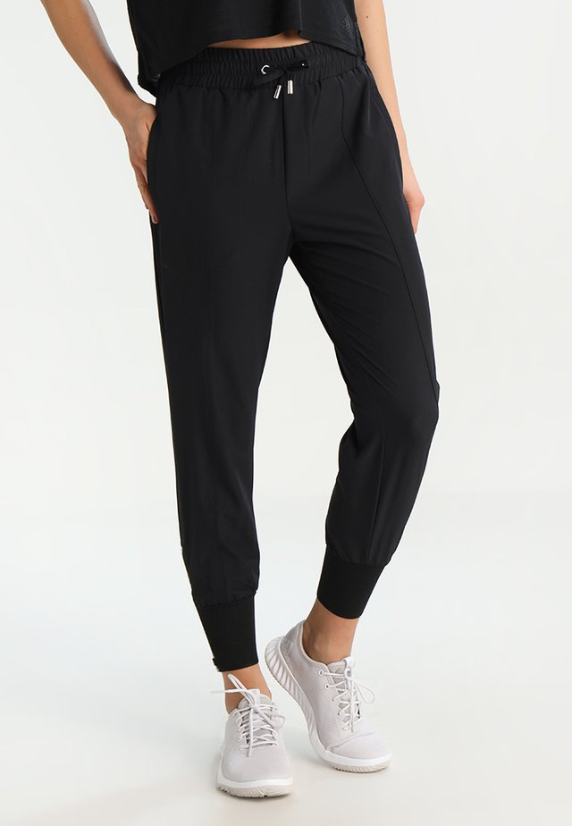 COMFORT PANTS - Tracksuit bottoms - black