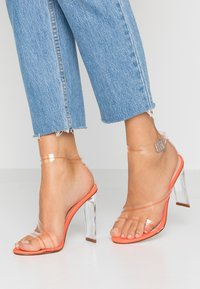 BEBO - ROCHELLE - Sandalen met hoge hak - clear/neon orange - 0