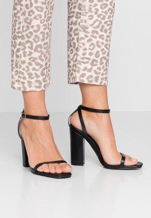 ANUSHA - Sandály na vysokém podpatku - black