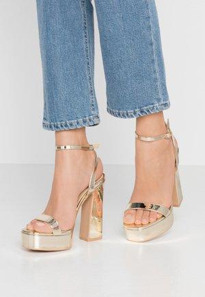 GIANNA - Sandaler med høye hæler - gold metallic