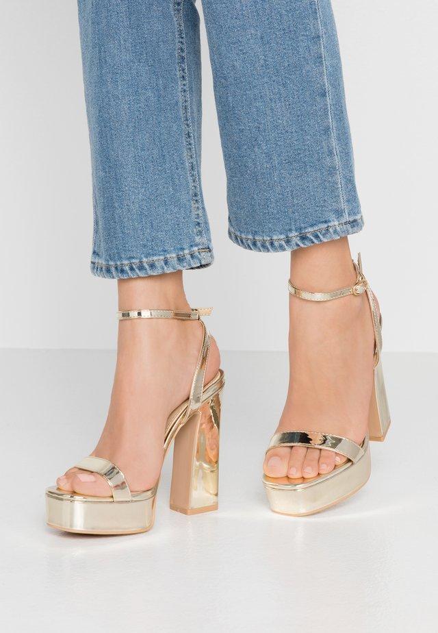GIANNA - Sandalen met hoge hak - gold metallic
