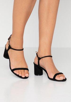 SANDRA - Sandals - black
