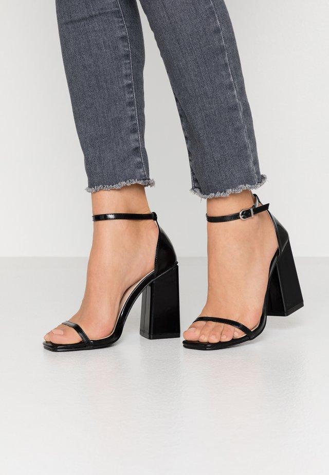ANWEN - Sandaletter - black