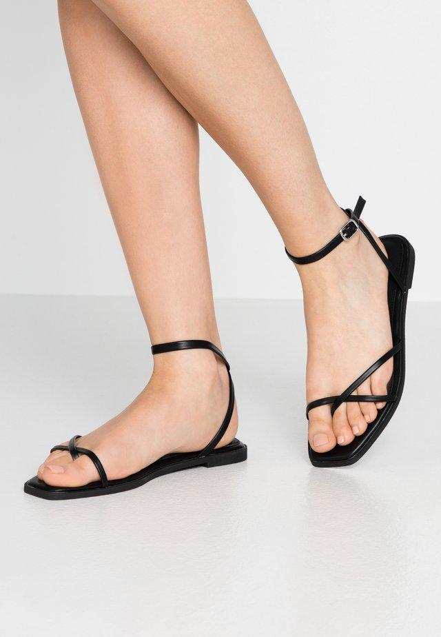 CANYON - T-bar sandals - black