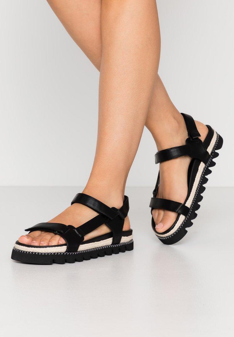 RAID - SONNIE - Sandaalit nilkkaremmillä - black