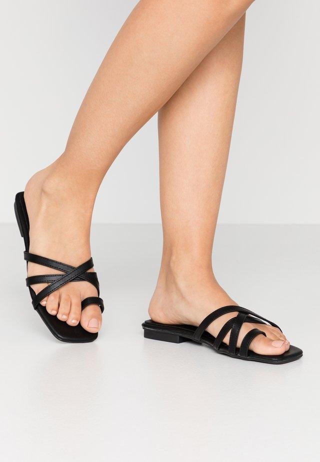 IZZIE - T-bar sandals - black
