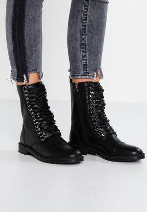 OVERA - Cowboy/biker ankle boot - black