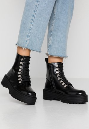 SOFIA - Platform ankle boots - black