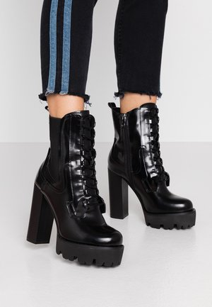 ASHLYN - Kotníková obuv na vysokém podpatku - black