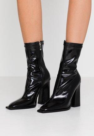 VALENCIA - Ankelboots med høye hæler - black
