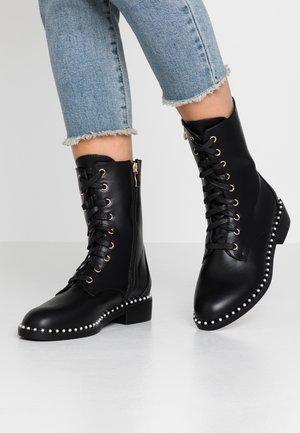 LACIE - Šněrovací kotníkové boty - black