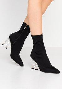 RAID - BRAZEN - Kotníková obuv na vysokém podpatku - black - 0