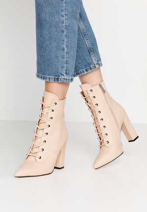 RAVEN - High heeled ankle boots - beige
