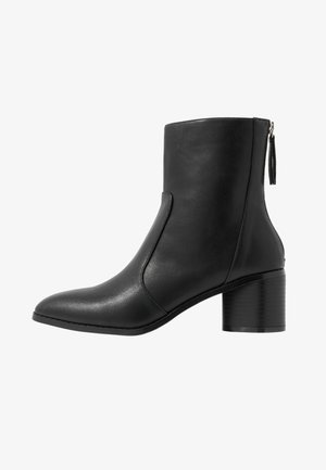 FAUNA - Kotníkové boty - black