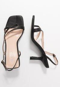 RAID Wide Fit - WIDE FIT ANINA - Sandály s odděleným palcem - black - 3