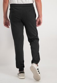 Ragman - Tracksuit bottoms - black - 2