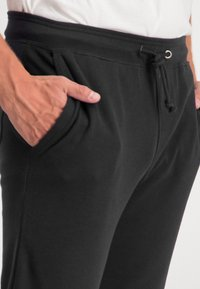 Ragman - Tracksuit bottoms - black - 5