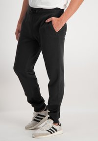 Ragman - Tracksuit bottoms - black - 3