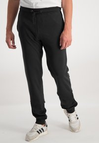 Ragman - Tracksuit bottoms - black - 0