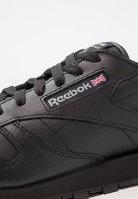 Reebok Classic - CLASSIC LEATHER CUSHIONING MIDSOLE SHOES - Trainers - black - 6
