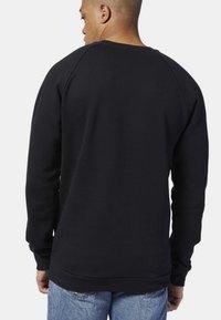 Reebok Classic - CLASSICS VECTOR CREW SWEATSHIRT - Sweatshirt - black - 1