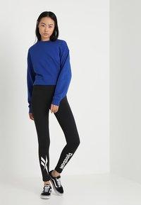 Reebok Classic - Leggings - Trousers - black - 1