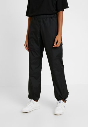 TRAIL TRACKPANT - Tracksuit bottoms - black
