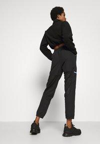 Reebok Classic - POCKET PANTS - Pantaloni sportivi - black - 2
