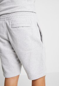 Reebok Classic - VECTOR  - Tracksuit bottoms - mottled light grey - 3
