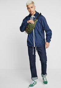 Reebok Classic - Summer jacket - navy - 1