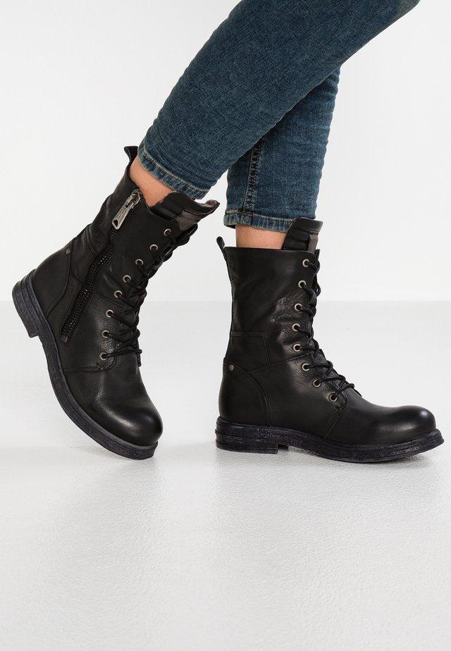 EVY - Cowboy/biker ankle boot - black