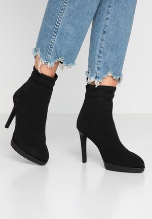 HIDEOUT - High heeled ankle boots - black