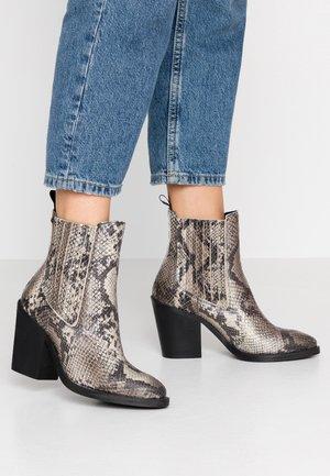 PORTEL - High heeled ankle boots - ecru/black
