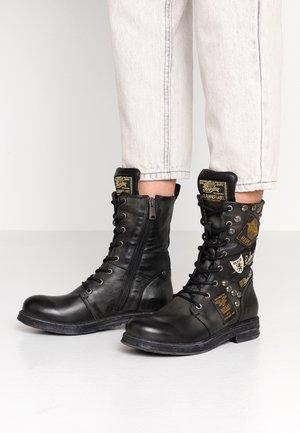 DUSTER - Cowboy/biker ankle boot - black