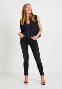 Replay - LUZ HYPERFLEX - Jeans Skinny Fit - black denim - 1