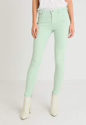 STELLA ANKLE ZIP - Trousers - pale green