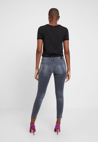 Replay - KAYTE HYPERFLEX - Jeans Skinny Fit - light grey - 2