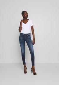 Replay - NEWLUZ HYPERFLEX BIO - Jeans Skinny Fit - dark blue - 1