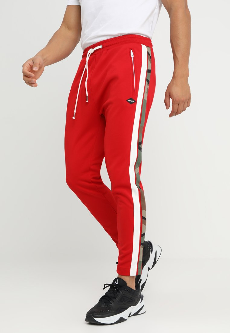 Replay - Tracksuit bottoms - ruby red
