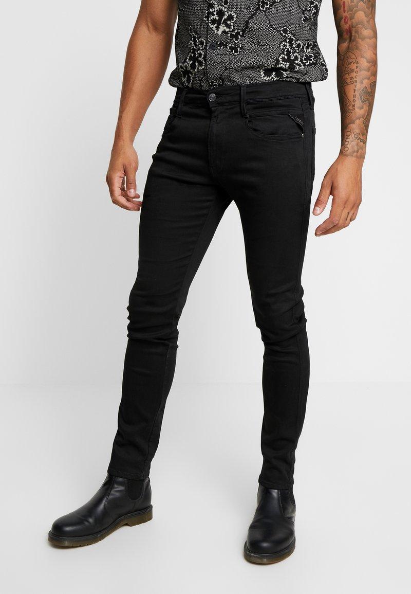 Replay - ANBASS HYPERFLEX - Slim fit jeans - black