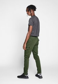 Replay - JAAN HYPERFLEX - Cargo trousers - hunter green - 2
